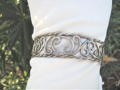 Vintage 1960s Sterling Silver swirling cut out design cuff bracelet #CuffBracelet