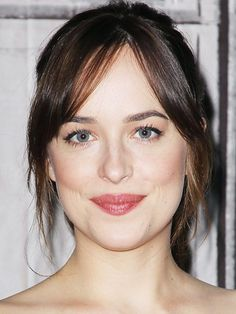 "Dakota Johnson has been doing ""curtain bangs"" way before they were trending. Here's a lesson in how to get this look right."