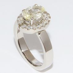 Symbolic 2 parts white golden ring with sapphire and diamonds