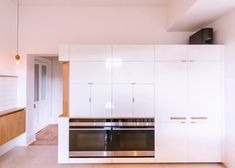 """Preston Lane Architects has renovated the kitchen inside a 19th-century house designed by British architect Henry Hunter – aiming to """"inject light and life"""" into the property."""