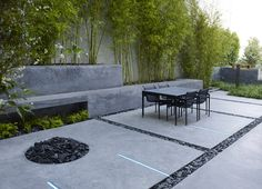 Concrete with lighting strips and black pebbles // SurfaceDesign