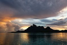 This photo from French Polynesia, Other is titled 'Bora Bora sunset'. Bora Bora French Polynesia, Tahiti, Oh The Places You'll Go, Places To Visit, Disneyland, Spiritual Photos, Ocean Quotes, Ocean Sunset, Places Of Interest