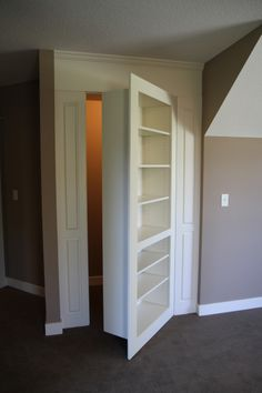 Bookshelf Reveals Hidden Closet