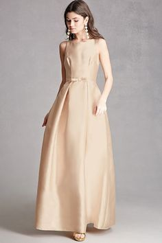 A satin gown featuring a round neck, V-back with concealed zipper closure, an attached bow-front belted detail, and inverted pleating throughout.  This is an independent brand and not a Forever 21 branded item.