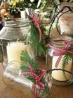 Jar candles. The little evergreen sprigs tied with red and white checked ribbons make an old jelly or pickle jar look like something from Pottery Barn, am I right?!