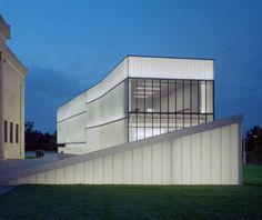 Bloch Building, Nelson Atkins Museum, Kansas City  Architect Steven Holl's five Modernist, frosted-glass boxes seem to shoot up from the museum's manicured sculpture garden, drenching natural light over their underground gallery spaces.