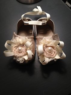 Fancy bow pearl baby girl crib shoe bootie. $16.00, via Etsy.