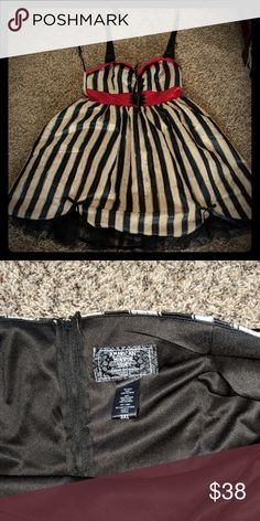 American Horror Story Freak Show costume dress American Horror Story Freak Show satin halter dress from Hot Topic. Runs small, would be best for a 1x. Satin with attached crinoline. Nice heavy dress. Gently used. Hot Topic Dresses Midi