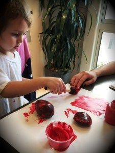 Painting rocks red to emphasize the letter R and it's sound.