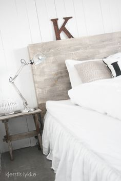 I think the white-washed wood would look really good with modern, gray bedding.