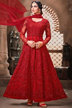 Dazzle everyone around as you walk into a wedding wearing this Red Net Anarkali Suit which makes it astonishingly charming. This Sweetheart neck and Full Sleeves garment embellished in zari, stone and sequins work. Present with Silk Straight Pant in Red Color with Red Net Dupatta. Straight pant has Zari, Stone and Sequins work