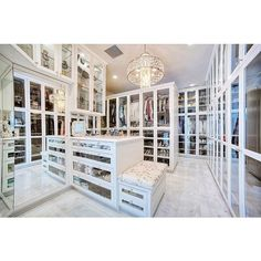 Walk In Closet with Mirrored Island - Contemporary - Closet ❤ liked on Polyvore featuring house