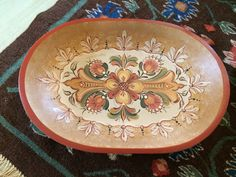 Hallingdal style oval bowl in soft gold, red, creamy white and green tones.