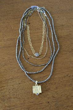 How to layer necklaces   styleblueprint.com