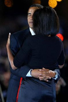 President Barak Obama Hugging 1st Lady Michelle Obama