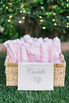 Pink Shawls in Wicker Basket at Reception  Photography: Troy Grover Photographers Read More: http://www.insideweddings.com/weddings/a-romantic-alfresco-destination-wedding-with-a-soft-color-palette/717/