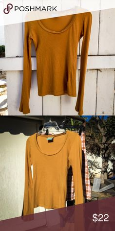 C&C California long sleeved cotton T-shirt This is from several years ago, when C&C California was known for expensive cotton t-shirts; it seems their product line has changed since then. This is the kind of shirt with very slightly long sleeves and a cut that skims your body: simply, yet foxy! The photos are both outdoors, so you can see the color in two outdoor lighting conditions. No stains, holes etc. Bundle and save! C&C California Tops Tees - Long Sleeve