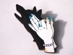 Wolf Shadow Puppets with Blue Nails Laser Cut Wood Brooch. $18.00, via Etsy.