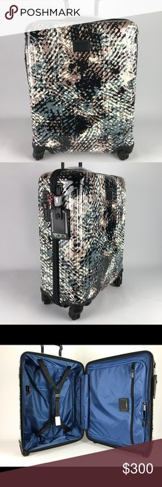"""Tumi Vapor Lite International Slim Carry-On Tumi's Vapor Lite hard side luggage is lightweight and durable. This carry-on is ideal for all types of travel. Its 4-dual wheel design allows it to turn in all directions making maneuverability a breeze. It has the TSA integrated combination lock with zipper closure. Its streamlined design has more packing capacity than meets the eye making it perfect for an overnight trip. Last photo for illustration, TOTE NOT INCLUDED 21.5"""" x 15.75"""" x 7.9"""" 36 L…"""