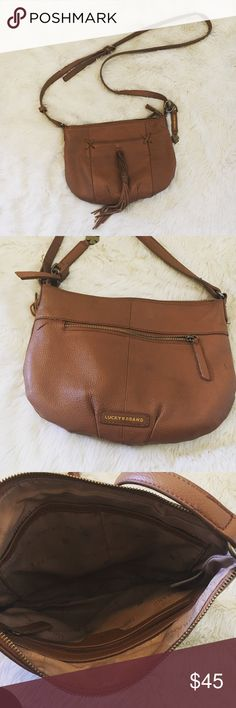 Lucky Brand Crossbody Super cute Crossbody bag A few minor flaws shown in the photos there is a little rubbing on the outside of the purse and a pen mark. Lucky Brand Bags Crossbody Bags