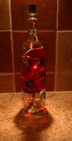 Handpainted Glass wine bottle lamp/light poppies by alisong2000
