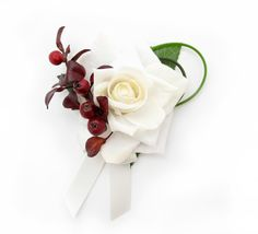 A corsage with autumn berries, an ivory Classic rose and bear grass loops. Find your perfect wedding flowers at https://www.loveflowers.com.au