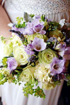 lavender fressia, green roses, yellow stock, lavender bridal boquet