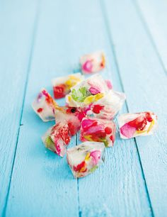 Don't these ice cubes with flower petals and herbs look refreshing and summery?