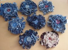 Denim Flowers.  Maybe to go on a pillow?  Oh MY...I am LOVING these!  I could see these in so many different ways....on pillows, purses, brooches, hair clippies....SO many different things.  :)