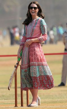 Catherine, Duchess of Cambridge, Kate Middleton, India. In honor of an afternoon round of cricket, Middleton changed into a flowy pink and seafoam tunic dress designed by Anita Dongre. She also switched out of her heels and into a pair of manageable nude wedges. Can't forget the sunglasses!