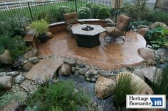 Peaceful backyard retreat area featuring a concrete patio surrounded by a stunning water feature and lush landscaping. Heritage Bomanite Fresno, CA Concrete Fireplace, Concrete Patio, Pula, Pervious Concrete, Rustic Landscaping, Yard Design, Porch Designs, Home Porch, Backyard Retreat