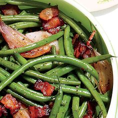 Skillet Green Beans | Pencil-thin green beans laced with crispy bits of pan-fried bacon and Candied Jalapeños turn up the heat on tradition. | #Recipes | SouthernLiving.com