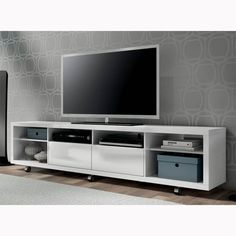 Easily maneuver the Cabrini TV Stand into place, with the convenient wheels for hassle-free arrangement. Mount your TV directly on the wall, or pair Cabrini TV Stand with the Cabrini TV Panel for a more finished look. Tv Stand And Panel, Tv Panel, Tv Stand On Wheels, White Tv Stands, Rack Tv, Tv Shelf, Furniture Deals, Furniture Outlet, Online Furniture