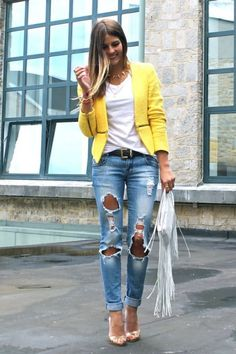 distressed jeans with yellow blazer
