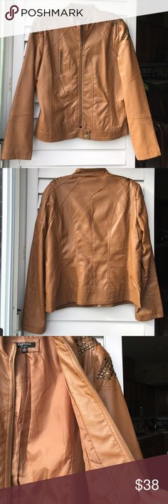 ✨NEW!✨ Fabulous Faux Leather Studded Jacket NWOT! This is amazing camel-colored faux leather jacket with gold stud detail! 😍 Size XL. NWOT and ready to be yours! Fully-lined. Pick this one up today and wear it with your favorite jeans and a great scarf for shopping this weekend! 👏👏👏🌹🎄✨ Clothes by Revue Jackets & Coats