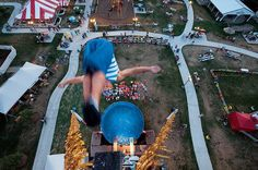 photo by @joelsartore | Throwing it back to a photo I took for my essay on state fairs.This diver clearly did not fear heights as he jumped off the 80-foot tower during a high dive act at the #Nebraska state fair. Talk about an adrenaline rush! Check out my feed @joelsartore to see more of my work. #TBT #joelsartore #photooftheday #fair #heights by natgeo