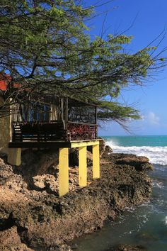 Rustic and colorful oceanfront cottages have private terraces on the water. #Jetsetter