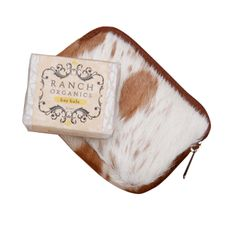 """NEW! Happy Trails Pocket Experience our popular """" Happy Trails """" in an adorable mini zippered genuine cowhide . Tucked in the pocket is a handmade 2 oz botanical soap in season on the ranch. A great gift from"""" Our Barn to Your Home"""""""