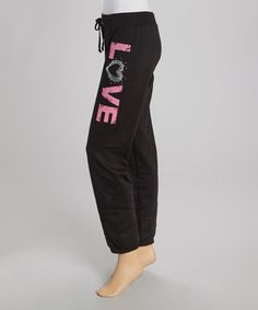Exude love and coziness with these drawstring sweatpants, perfect for casual cuffing and laid-back lounging.