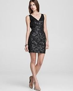 An edgy metallic floral print enriches this glamorous party-going GUESS dress. $57.82
