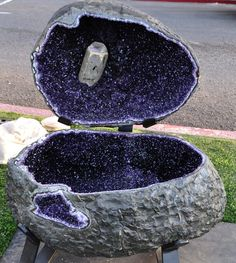 Large amethyst geode with a large hexagonal calcite crystal inside  Photo credit: Steven Bookbinder