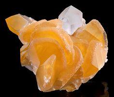 Beautiful specimen featuring blades of Orange Calcite on Quartz points!