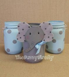 These adorable elephant set of mason jars is an original Fuzzy Firefly Creation. This listing is for the set of 3 jars. The set includes the elephant and 2 grey and blue polka dot jars. The elephant has a dimensional head and blue bow. The jar is accented with a matching ribbon around