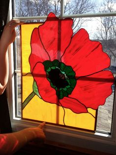 """i have a stained glass poppy. vibrant colours of yellow,red,green and black. the panel can be hung on the wall or in a window. perfect condition. 23""""x19"""""""