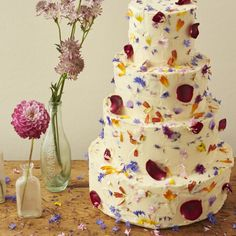 Petal confetti wedding cake from the talentedhttp://beesbakery.co.uk with edible petal confetti from http://maddocksfarmorganics.co.uk Edible Flowers. Petal Confetti