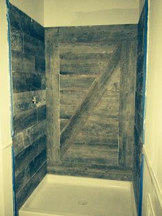 This shower was newly tiled with a new plank tile that has a weathered barnwood look. The tile was used to recreate the look of a barn door. My phone camera doesn't do the colors justice. It is actually a light gray. This shower is in the private bath of our Riesling's Retreat room.  We liked that it was something different that you really don't see anywhere else.  We're putting in oiled bronze fixtures (a rain showerhead)