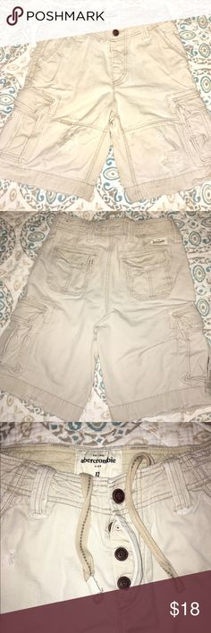 Boys Abercrombie kids cargo shorts 12 Abercrombie kids boys size 12 cargo shorts. Off white very thick material with a distressed look to them. Button fly and adjustable waist. abercrombie kids Bottoms Shorts