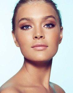 Glowing golden tan, soft smokey eye, rose blush, nude lip. Lovely makeup for tanned skin! #TanningTips