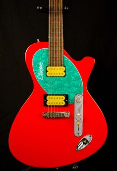 Fleck Electric Guitar $3200.00 Nice asymmetrical shape, bold colors, and I like the lower cut-away. You see the flow of the body behind the neck. It looks a little off balanced though with the expanse of body behind the bridge.