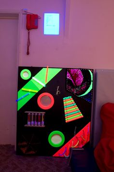 This is so awesome and TJ would love it!  Sensory wall for a dark sensory room...brilliant